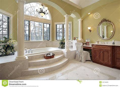 Master bath with columns stock photo. Image of residence