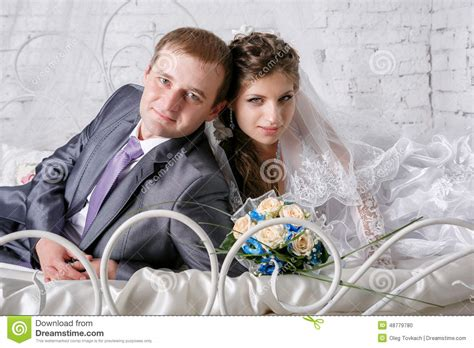 lovely couple in bed lying in bedroom lovely couple in bed lying in bedroom beautiful young couple lying on bed stock photo
