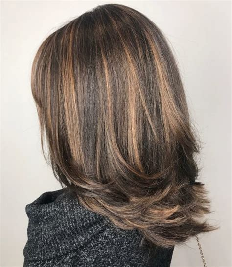 chocolate hair color with caramel highlights 27 most delectable caramel highlights you ll see in 2018