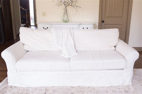 pottery barn couch how to put on a pottery barn sofa slipcover home