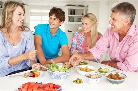 3 family at dinner table about lifestyle issues