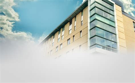 building with sky and clouds ppt business powerpoint templates