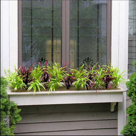 window plants filling window boxes with artificial outdoor plants