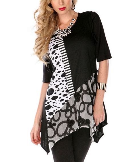 Sassy Tunik Blouse boost any wardrobe with this sassy tunic featuring medley of spots and stripes it s sure to