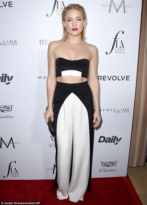 Fashion Hudson kate hudson flashes midriff in two jumpsuit for