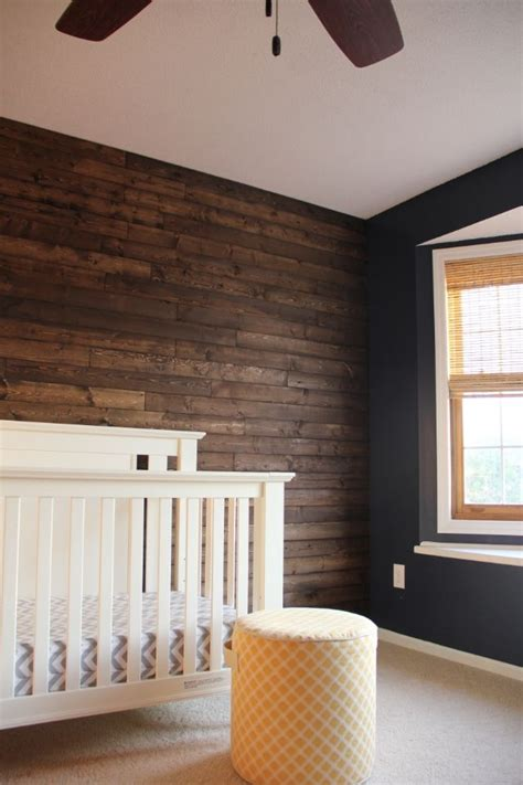 wood panel accent wall wood panel wall in nursery diy boy nursery rustic