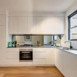mirror in kitchen 6mm porcelain benchtop mirror splashback black tapeware kings lane terraces pinterest
