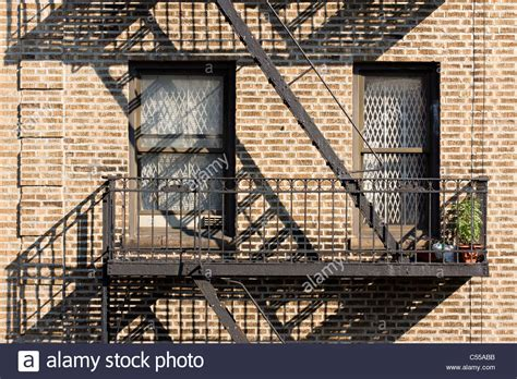 Security For Apartment Windows Brick Apartment Building With White Security Bars On The