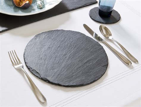 set of slate place mats and drinks coasters