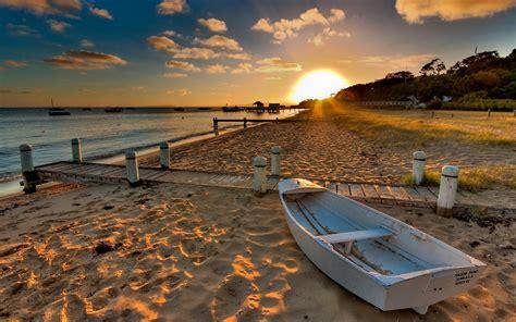 wallpaper beach sand boat sunset water  full