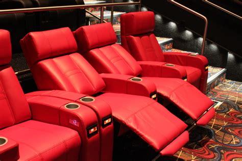 cineplex recliner seats movie theaters are adding comfy seats booze even