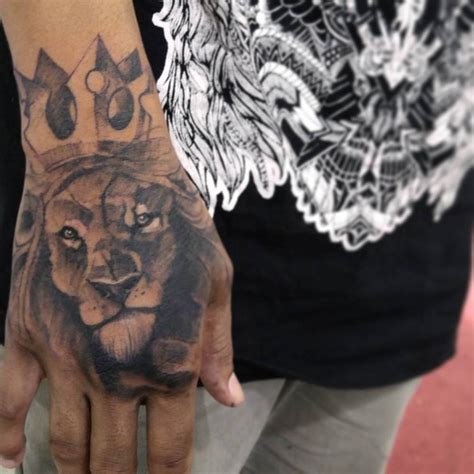 lion hand tattoo sketchy style king on the right