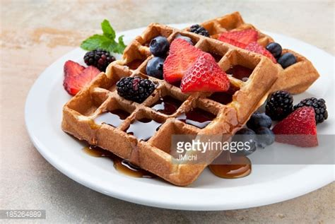 fruit waffles waffles with fruit and maple syrup on a marble counter