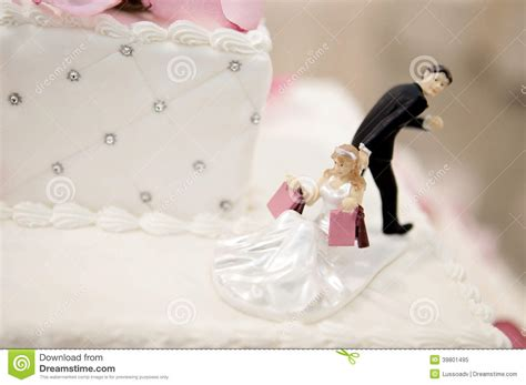 And Groom Photos by And Groom Cake Toppers On A Wedding Cake Stock Image