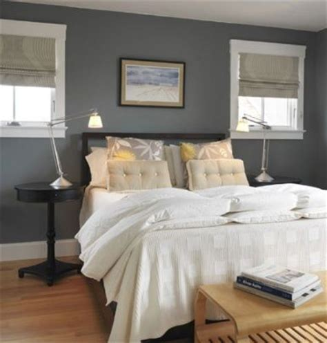 warm grey bedroom dark grey blue feature wall with warm timber floor and