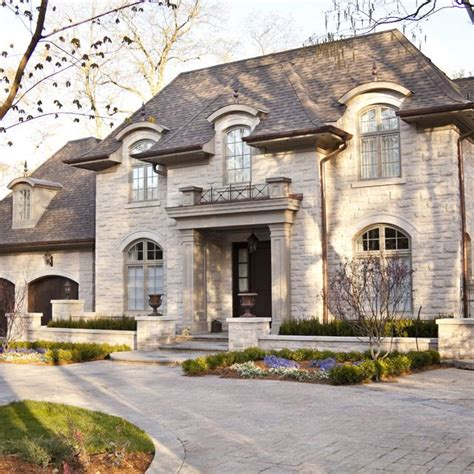 french chateau french home exterior robert dame designs david small designs is an award winning custom home design