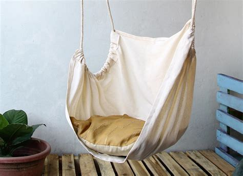 simple diy ceiling hanging chair from white fabric