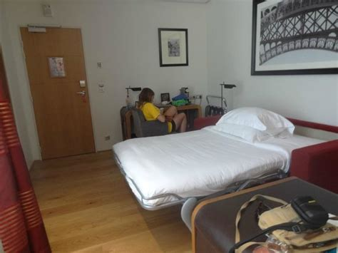 living out of a hotel room fold out sofa in living room picture of hotel le six tripadvisor