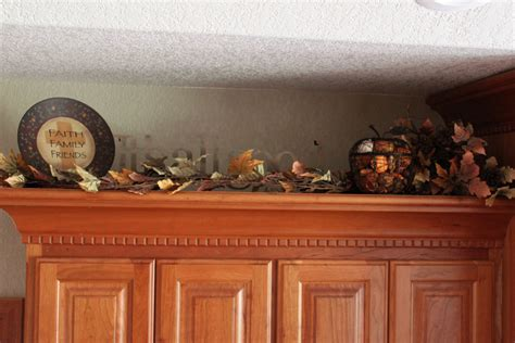 kitchen decorations for above cabinets fall decor it s still