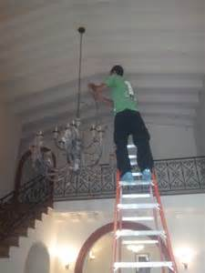 how to clean chandeliers on high ceiling high ceiling chandelier installation one item move los