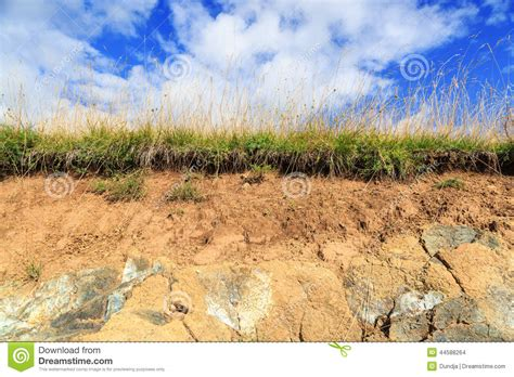 soil cross section ground and sky stock photo image of wasteland blue