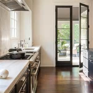 Kitchen Interior Doors kitchen with a white plastered kitchen hood flanked by windows