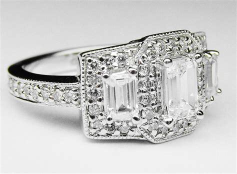 engagement ring emerald cut vintage style three