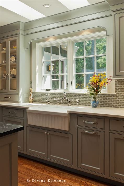 transitional kitchen with gray cabinets and farmhouse sink gray cabinets white countertops and a farmhouse sink