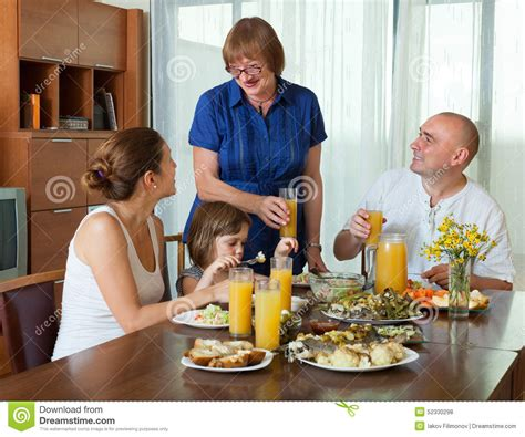 three generations family table stock photo image