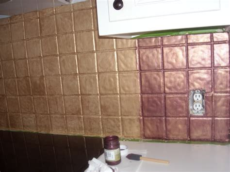 how to paint tile backsplash in kitchen yes you can paint tile i turned my backsplash kitchen tiles into faux metal tiles