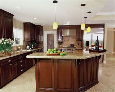 kitchens with cherry cabinets a luxury kitchen with cherry cabinets and a large island