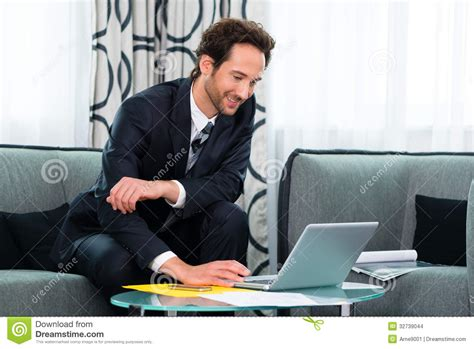 businessman in hotel working on laptop stock images