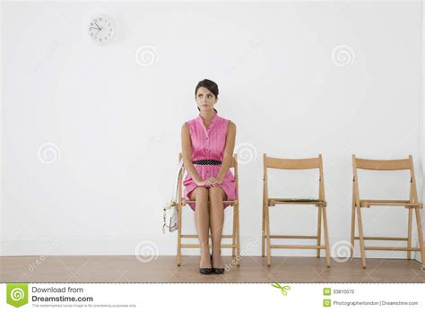 sitting in waiting room stock photo image