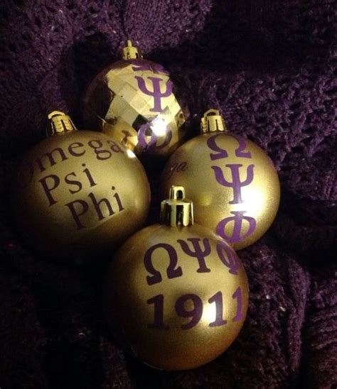 gold fraternity ornament set inspired by omega psi phi