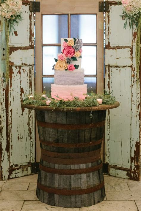 Barrel Planter Lowes by Rustic Cake Table Two Planter Barrels And Stain A Top