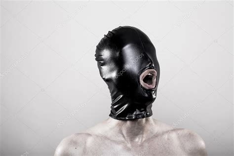 rubber st faces with black rubber mask blindfold stock photo