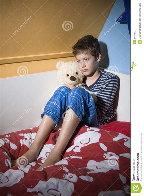 boys in bed sad and depressed boy on his bed stock image image 34808737