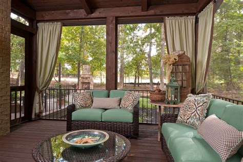 screened in porch curtains bright wicker loveseat in porch traditional with sunroom
