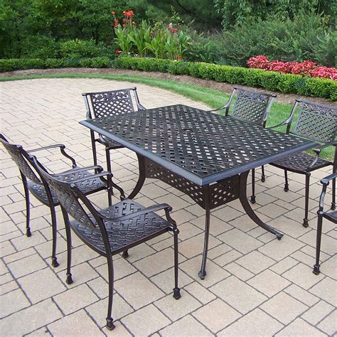steel patio furniture oakland living 7 pc cast metal outdoor dining set with rectangular table and 6 stackable