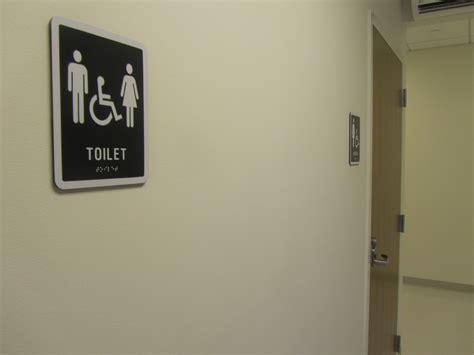 uni bathroom signs new single use gender neutral signage installed on