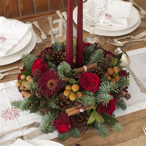 christmas fresh fir and flower centrepiece by the flower