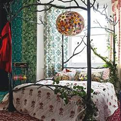 woodland bedroom with iron four poster bed woodland