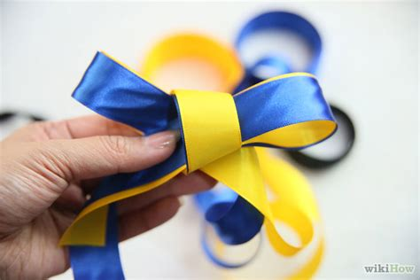 How To Make A Ribbon Bow Out Of Paper - make a bow out of a ribbon step 3bullet1 version 2 jpg
