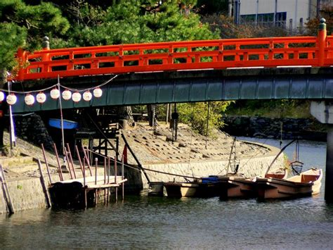 fishing boat restaurant japan bridges and boats on the uji river kyoto japan travel