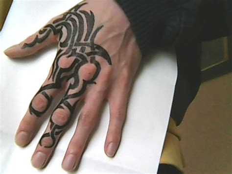 tattoo on hand bad idea hand tattoo 5 tribal by chromone on deviantart