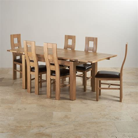 Solid Oak Dining Tables And Chairs Dorset Dining Set Extending Table In Oak 6 Leather Chairs
