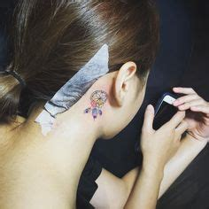 orchid tattoo behind ear 1000 images about tattoos on women on pinterest