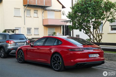 red porsche panamera porsche panamera turbo s e hybrid in deep red looks a