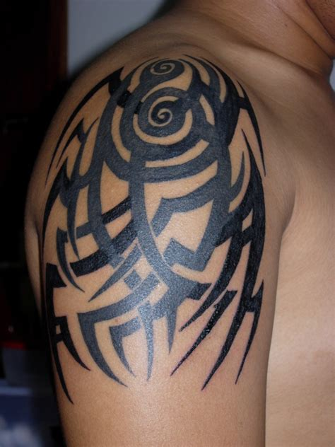 covering tribal tattoos tribal shoulder cover up rework tribal tattoos