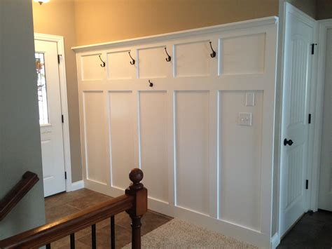 wainscoting foyer entryway wainscoting with hooks for coats and a shelf for